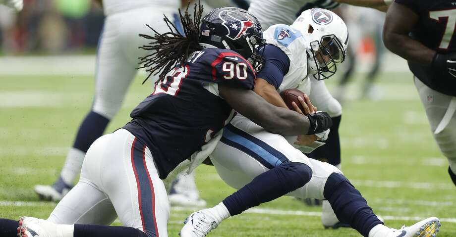 Houston Texans defensive end Jadeveon Clowney (90) sacks Tennessee Titans quarterback Marcus Mariota (8) during the third quarter of an NFL football game at NRG Stadium, Sunday, Oct. 2, 2016 in Houston.  ( Karen Warren / Houston Chronicle ) Photo: Karen Warren/Houston Chronicle