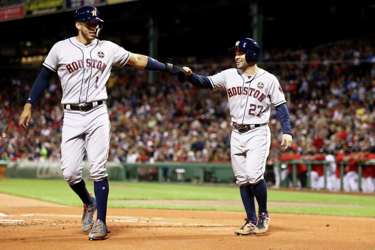 BOSTON, MA - SEPTEMBER 28: Carlos Correa #1 of the Houston Astros and Jose Altuve #27 celebrate after scoring runs against the Boston Red Sox during the first inning at Fenway Park on September 28, 2017 in Boston, Massachusetts.