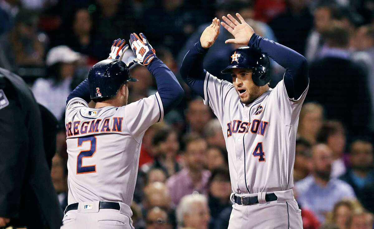 Houston Astros' Alex Bregman (2) is congratulated by George Springer, right, after hitting a two-run home run off Boston Red Sox starting pitcher Eduardo Rodriguez during the second inning of a baseball game at Fenway Park in Boston, Thursday, Sept. 28, 2017. (AP Photo/Charles Krupa)