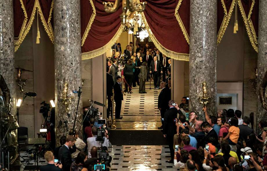House Majority Whip Steve Scalise, R-La., accompanied by his wife, walks through National Statuary Hall to his office on his return back to Capitol Hill after being critically wounded by a gunshot 15 weeks ago. Photo: Photo By Melina Mara For The Washington Post. / The Washington Post