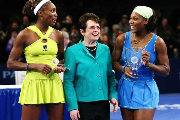 Venus Williams, Billie Jean King and Serena Williams pose for photographs after a 2009 match in New York Citythe Final during the BNP Paribas Showdown for the Billie Jean Cup at Madison Square Garden on March 2, 2009 in New York City. (Photo by Chris McGrath/Getty Images)