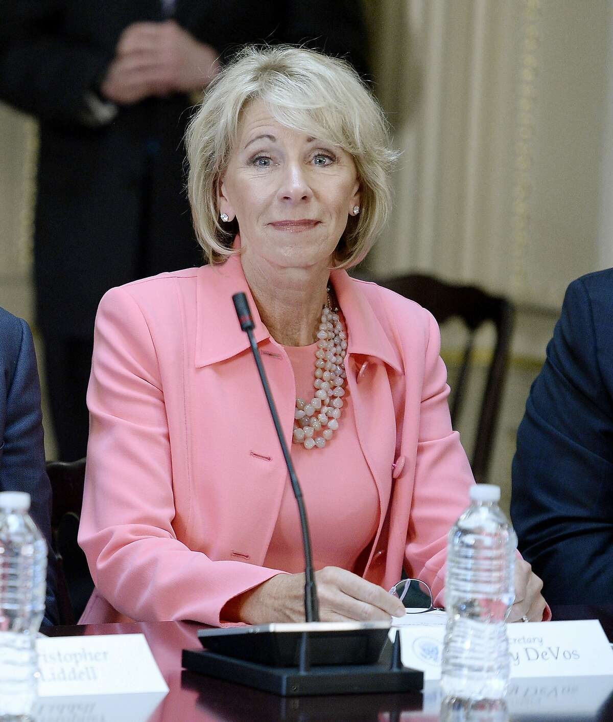 Education Sec. Betsy DeVos listens as U.S. President Donald Trump speaks during a strategic and policy discussion with CEOs in the State Department Library in the Eisenhower Executive Office Building on April 11, 2017, in Washington, D.C.