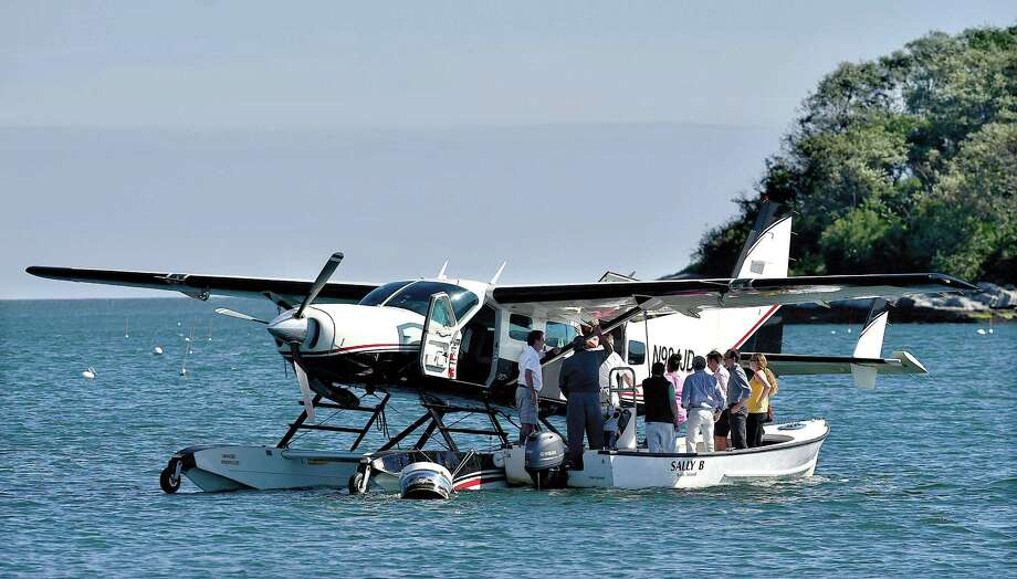 Members of the community board a seaplane from Shoreline Aviation of East Haven at West Wharf Beach in Madison, Thursday, Sept. 28, 2017, as Wings-2-Madison announce its seaplane service from Manhattan to Madison and charter options to Long Island, Martha's Vineyard and Cape Cod. Photo: Catherine Avalone / Hearst Connecticut Media / New Haven Register