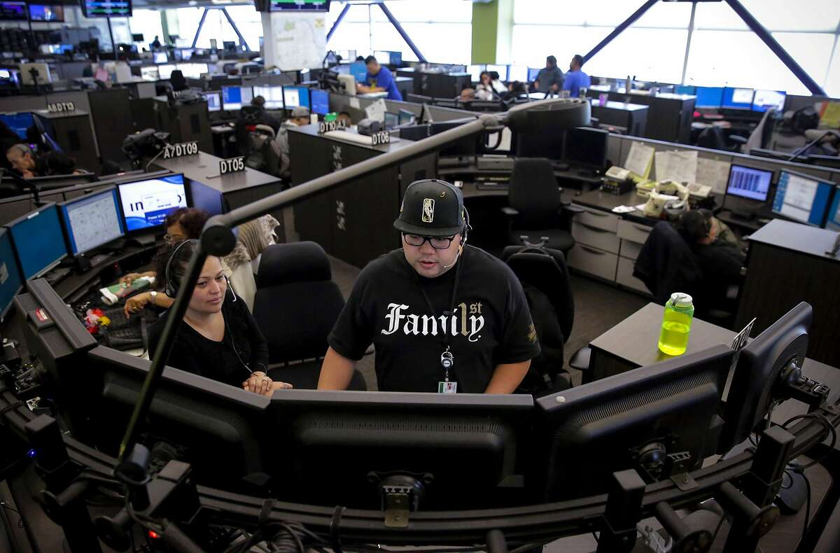 Dispatcher Debora Zambrano, (left) with Arnel Laxa, a trainee at the San Francisco 911 Emergency Call Center on Mon. July 31, 2017 in San Francisco, Ca.