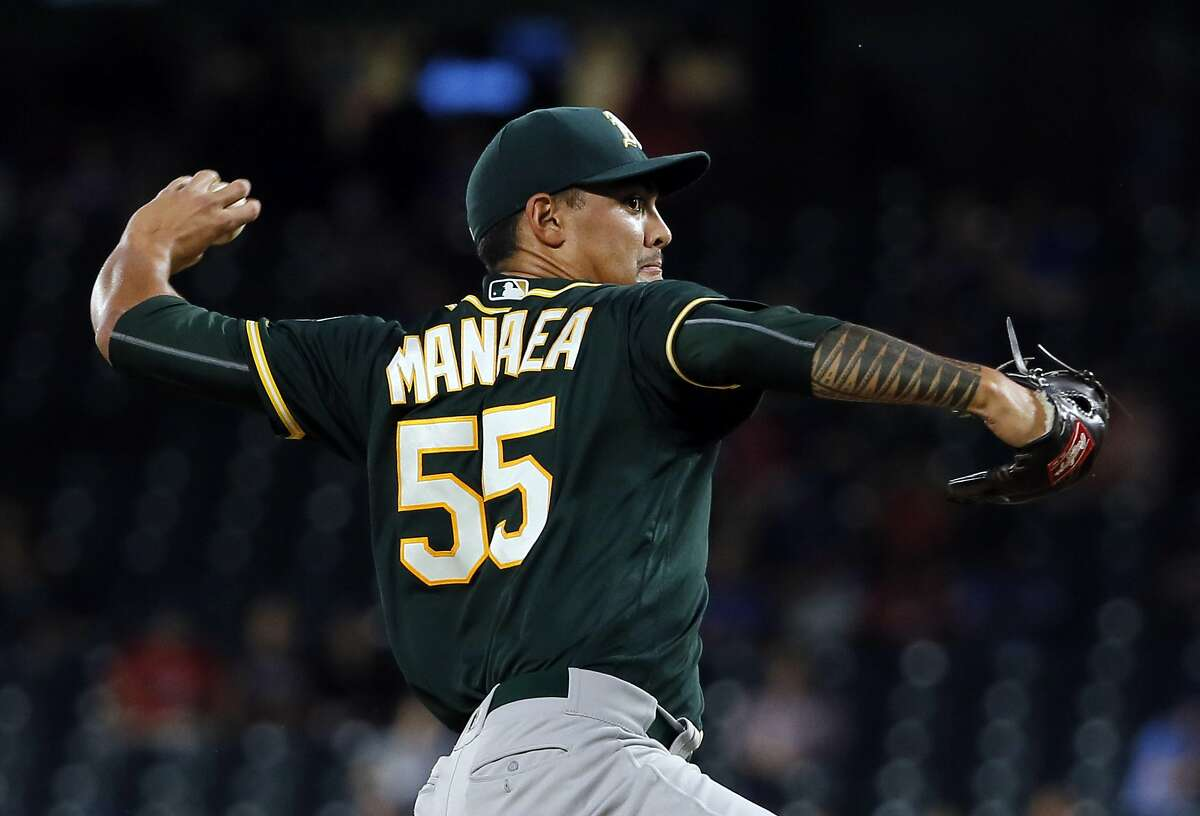 Oakland Athletics starting pitcher Sean Manaea (55) throws to the Texas Rangers in the first inning of a baseball game, Thursday, Sept. 28, 2017, in Arlington, Texas. (AP Photo/Tony Gutierrez)