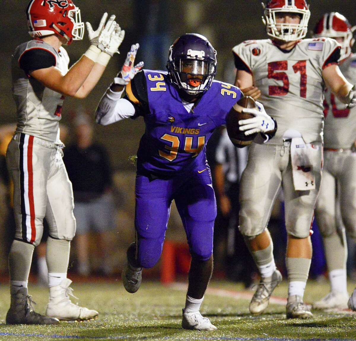 Westhill Nicholas Nunes celebrates a Viking touchdown against New Canaan to end the first half in a FCIAC football game at Boyle Stadium in Stamford, Connecticut on Thursday, Sept. 28, 2017.