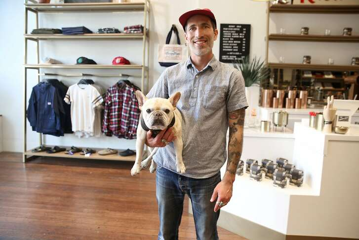 Benny Gold with his dog Levi in his store on Friday, September 1, 2017, in San Francisco, Calif.