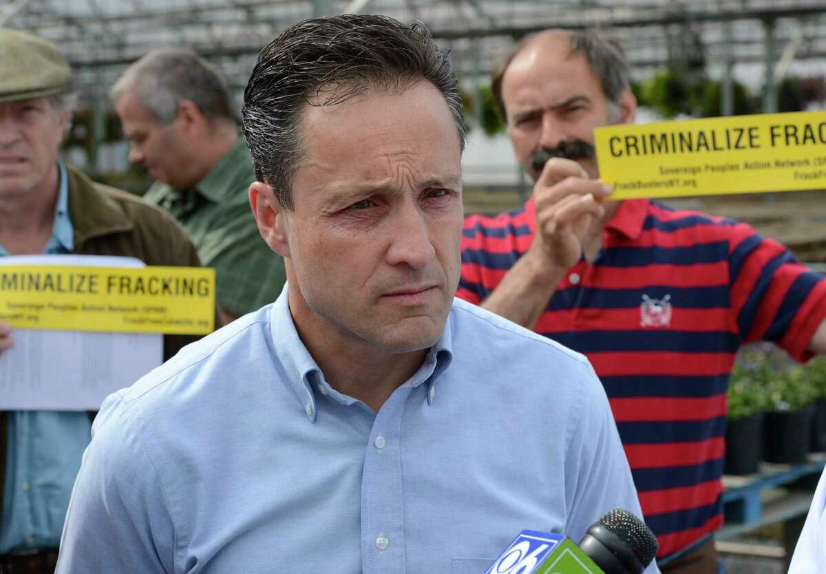 Assemblyman Pete Lopez is flanked by fracking protestors during a discussion of a proposed gas pipeline in Schoharie County on July 10, 2012, at a press conference at the Schoharie Valley Farm in Schoharie, N.Y. (Skip Dickstein / Times Union archive)