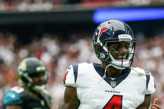 Houston Texans quarterback Deshaun Watson (4) reacts after throwing a touchdown pass in the second half as the Houston Texans lose to the Jacksonville Jaguars 29-7 at NRG Stadium Sunday, Sept. 10, 2017 in Houston. ( Michael Ciaglo / Houston Chronicle)