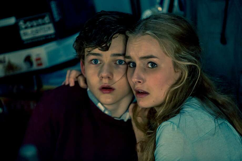Babysitter Ashley (Olivia DeJonge) and Luke (Levi Miller) are terrorized by an intruder, but Luke has one more surprise. Photo: Well Go USA