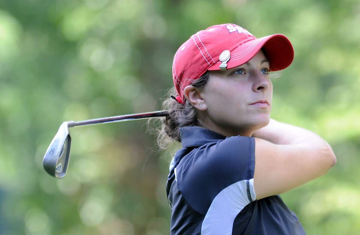 Jen Tierney watches her ball Sunday during the Danbury Amateur golf championship at Richter Park, July 18, 2010.