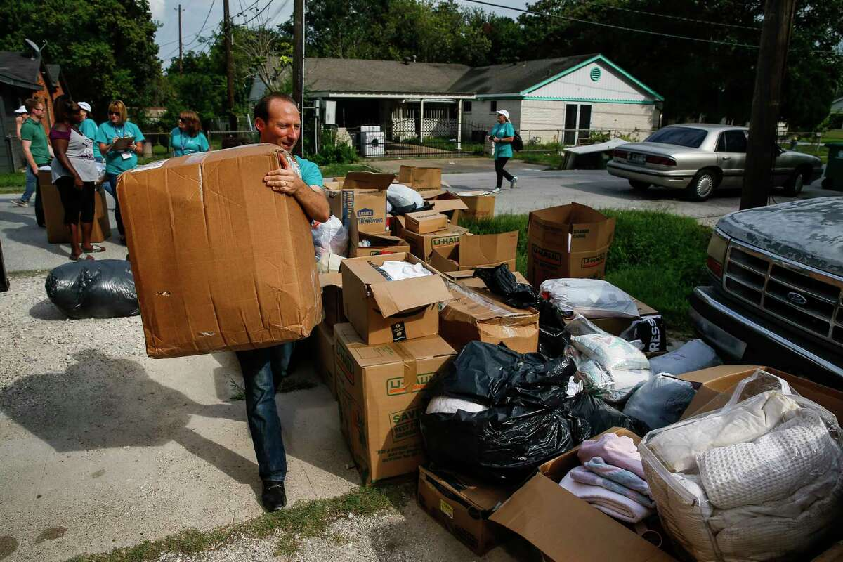 Catholic Charities USA member Patrick Fisher, from Chicago, unloads a truck full of supplies donated from people in Pittsburgh in Kashmere Gardens.