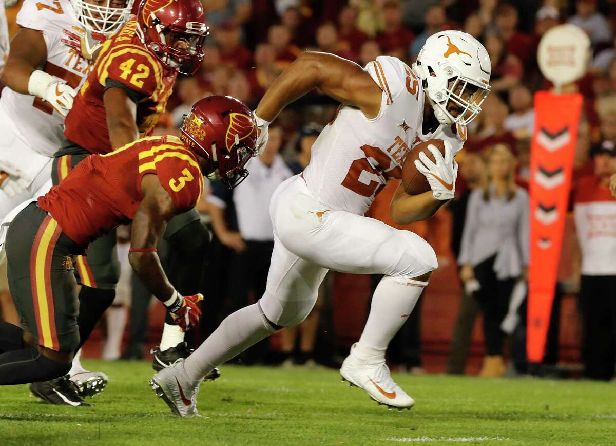 AMES, IA - SEPTEMBER 28: Running back Chris Warren III #25 of the Texas Longhorns drives the ball into the end zone as defensive back Reggie Wilkerson #3, and linebacker Marcel Spears Jr. #42 of the Iowa State Cyclones defend in the first half of play at Jack Trice Stadium on September 28, 2017 in Ames, Iowa.