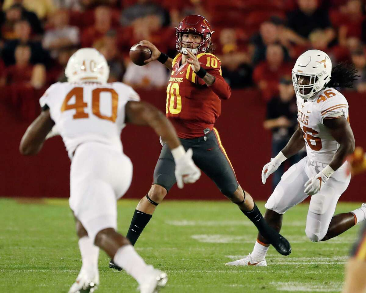 Iowa State quarterback Jacob Park (10) looks to throw past Texas defenders Naashon Hughes (40) and Malik Jefferson (46) during the first half of an NCAA college football game, Thursday, Sept. 28, 2017, in Ames, Iowa. (AP Photo/Charlie Neibergall)