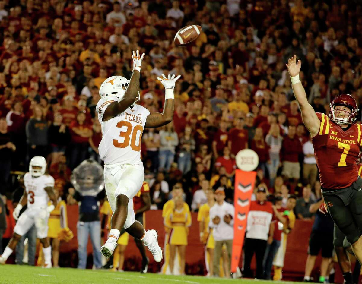 AMES, IA - SEPTEMBER 28: Running back Toneil Carter #30 of the Texas Longhorns pulls in a touchdown pass over linebacker Joel Lanning #7 of the Iowa State Cyclones in the first half of play at Jack Trice Stadium on September 28, 2017 in Ames, Iowa.