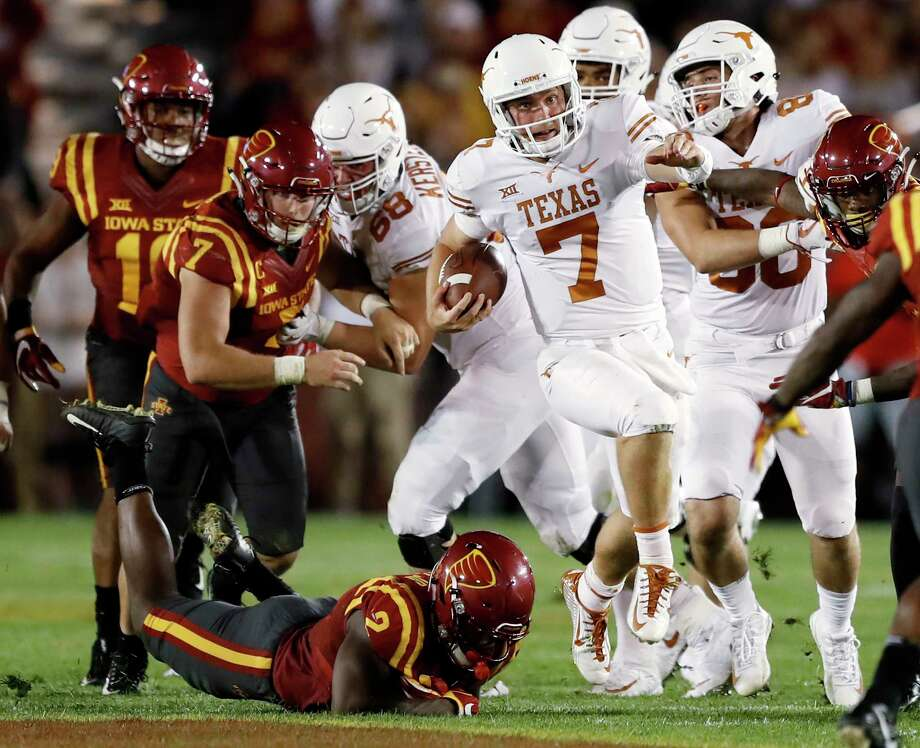 Texas quarterback Shane Buechele (7) carries against Iowa State during the first half of an NCAA college football game, Thursday, Sept. 28, 2017, in Ames, Iowa. (AP Photo/Charlie Neibergall) Photo: Charlie Neibergall, STF / Copyright 2017 The Associated Press. All rights reserved.