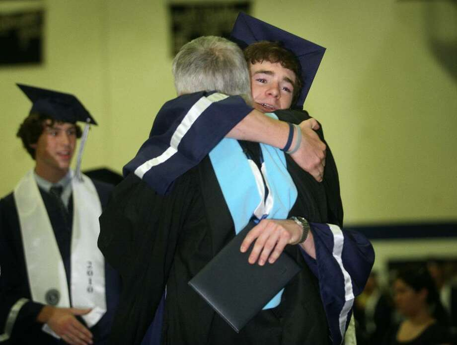 Graduate Jack Hennessy hugs Principal John Dodig after receiving his diploma at the Staples High School graduation, Wednesday afternoon, June 23, 2010 in Westport. Photo: Brian A. Pounds / Connecticut Post