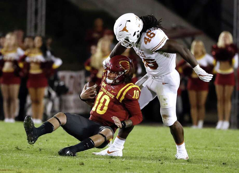 Quarterback Jacob Park of the Iowa State Cyclones is sacked by linebacker Malik Jefferson of the Texas Longhorns in the second half of play at Jack Trice Stadium on Sept. 28, 2017 in Ames, Iowa. Photo: David Purdy /Getty Images / 2017 Getty Images