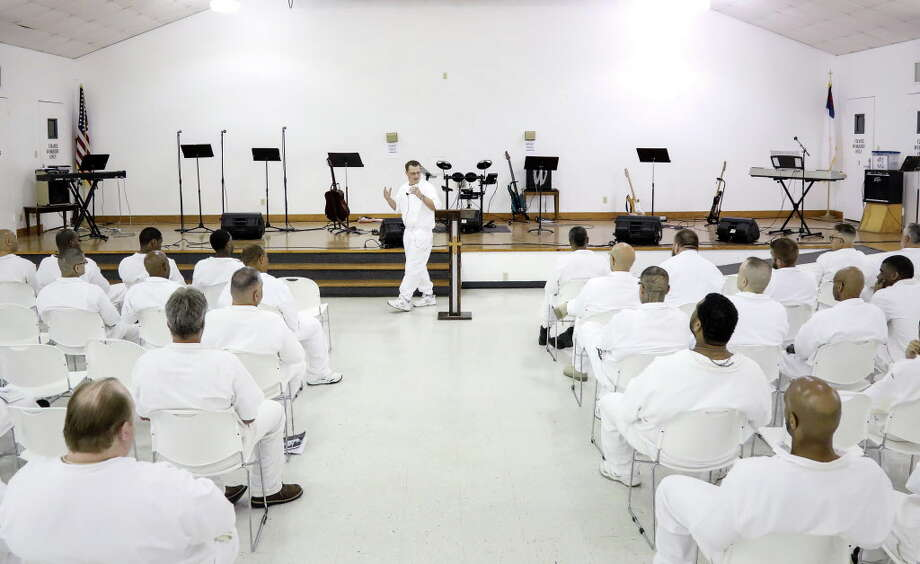 "Brandon Brewer, rear center, who is serving a 60-year sentence for murdering his mother, delivers his first sermon at the Connally Unit in Kenedy, Texas. ""My biggest focus is building relationships with these men, and letting them know they can still live life,"" he said. Photo: Jon Shapley, Houston Chronicle / © 2017 Houston Chronicle"