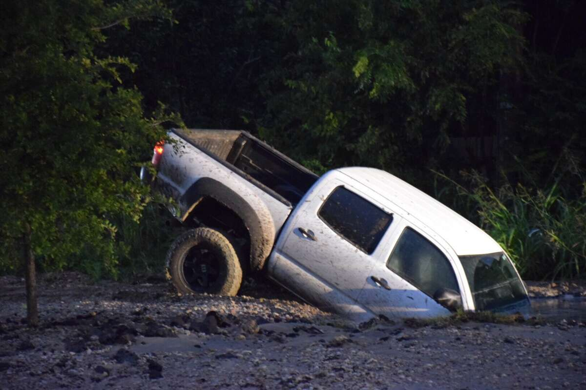 An off-duty police officer crashed his pickup truck into a sinkhole Friday morning on the Southeast Side.
