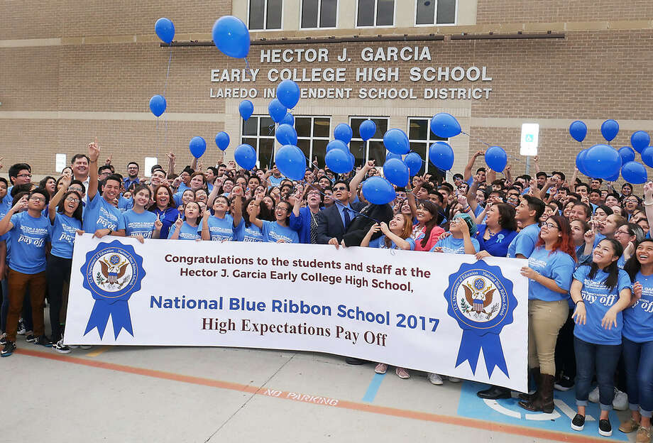 LISD and TAMIU administrators celebrate alongside administrators, faculty and students of the Hector J. Garcia Early College High School after they were recognized as a National Blue Ribbon School for 2017, Thursday, September 28, 2017. Photo: Cuate Santos/Laredo Morning Times