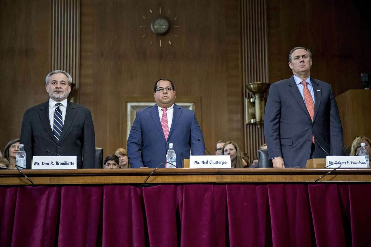 Dan Brouillette, deputy secretary of energy nominee for U.S. President Donald Trump, from left, Neil Chatterjee and Robert Powelson, nominees to be a members of the Federal Energy Regulatory Commission (FERC) for Trump, answer questions while standing during a Senate Energy and Natural Resources Committee nomination hearing in Washington, D.C., U.S., on Thursday, May 25, 2017. Federal lawmakers and industry groups including the Independent Petroleum Association of America and American Petroleum Institute have been urging Trump to fill the three vacancies at FERC quickly since the agency lost the quorum it needs to make major decisions in February. Photographer: Andrew Harrer/Bloomberg