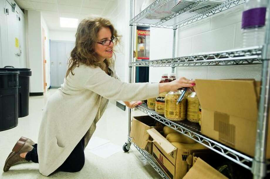 Stacey Mieske of Auburn takes inventory of food items during preparations for the upcoming annual Smorgasbord and Country Store on Tuesday at Zion Lutheran School in Auburn. The event will take place in the school's gymnasium on Oct. 1 and will feature tables piled high with chicken, mashed potatoes and gravy, squash, baked beans, sweet breads and pies. (Katy Kildee/kkildee@mdn.net)