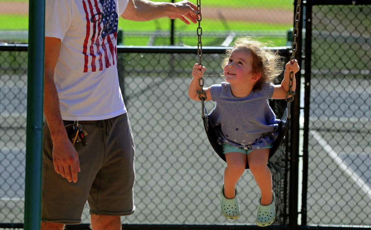 Era Pali, 3, of Fairfield, gets pushed on the swing by her dad David at Tunxis Hill Park on Sept. 22.