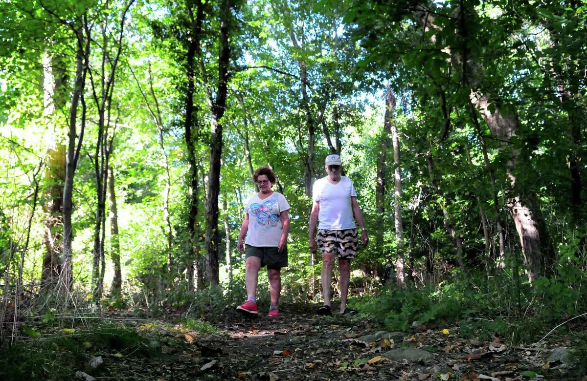 Anna Maria Gosp and her husband Jose take a stroll through Gypsy Springs Open Space near Beaver Street in Fairfield, Conn., on Friday Sept. 22, 2017.