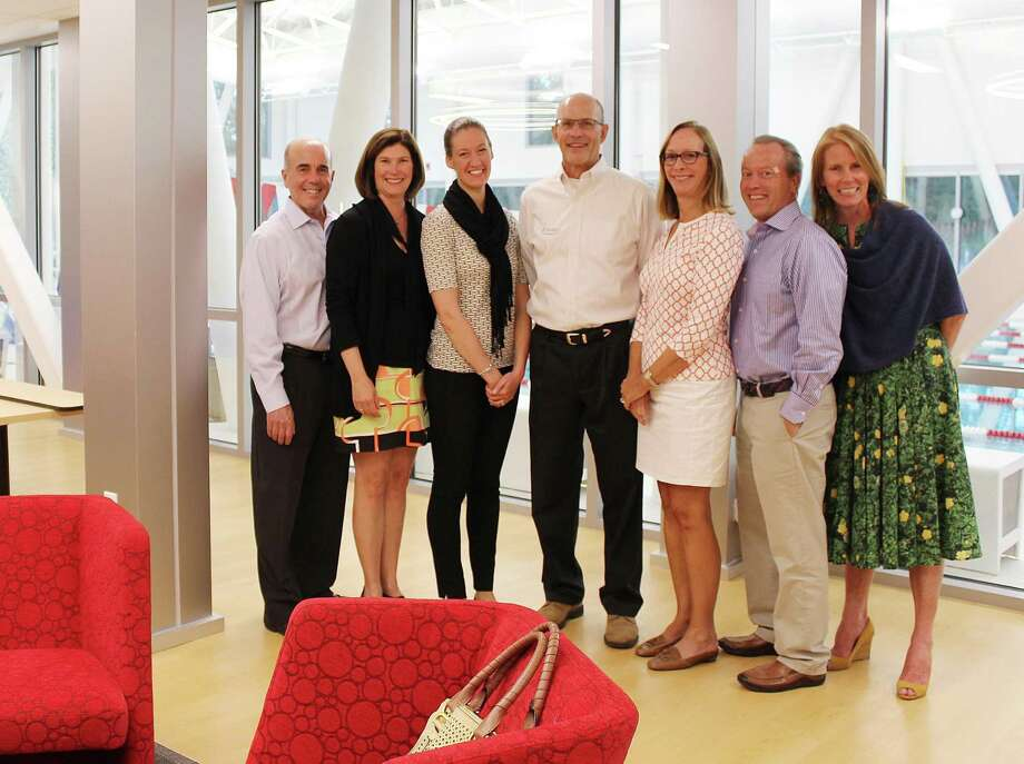 Members of the New Canaan Community Foundation joined New Canaan YMCA representatives to celebrate the opening of the new cafe at the Y. From left, Peter Skaperdas, Kathleen Abbott, Lauren Patterson, Craig Panzano, Sharon Stevenson, Leo Karl and Sharon McClymonds. Photo: Contributed Photo / New Canaan News
