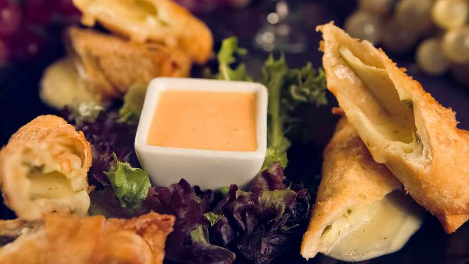 Cheesy Fried Pickles from The Funky Door in Lubbock. This quick and easy app was inspired by the owner's pregnant daughter with three effortless ingredients: Havarti cheese strips, sliced dill pickles and wonton wrappers, served with a Sriracha Ranch dressing.