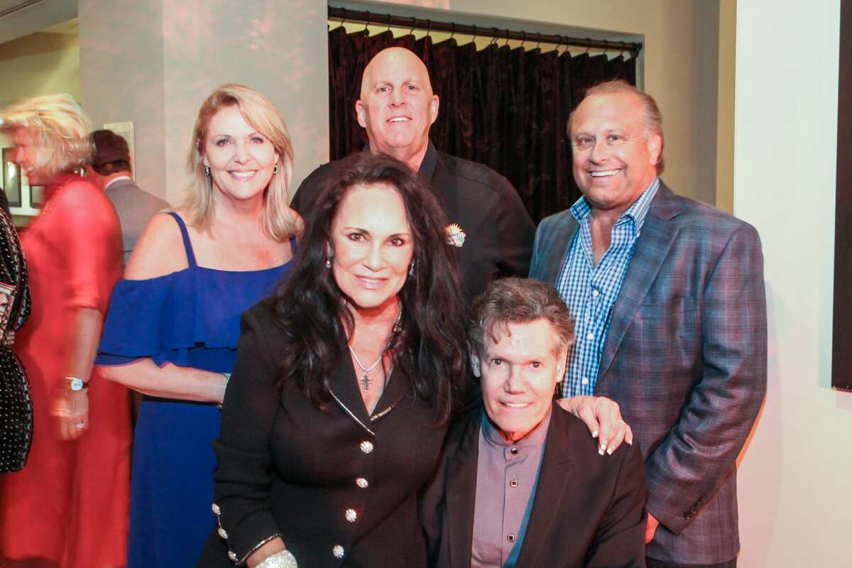(Front row) Mary and Randy Travis with Tinti Moffat, Mike Malone and Al Weir