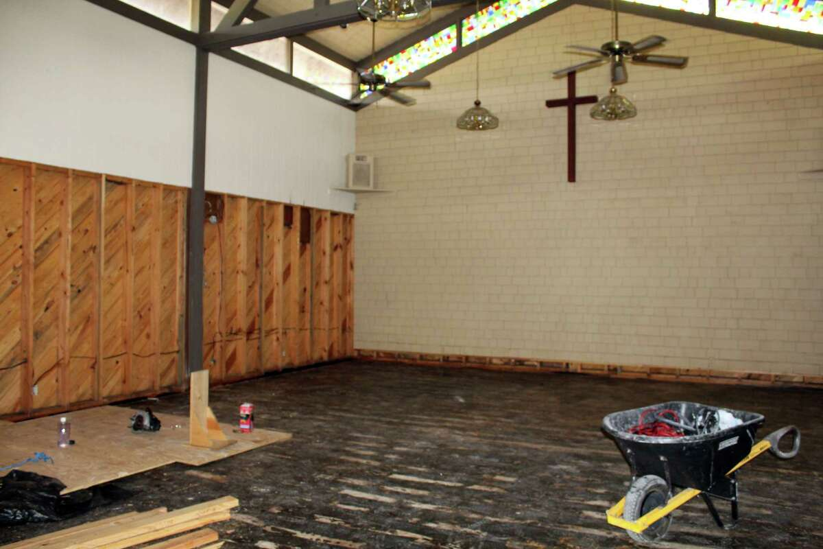 The hardwood floors of the original sanctuary at Lake Houston United Methodist Church in Huffman had to be ripped up due to flooding during hurricane Harvey, and now sit in piles next to the church.