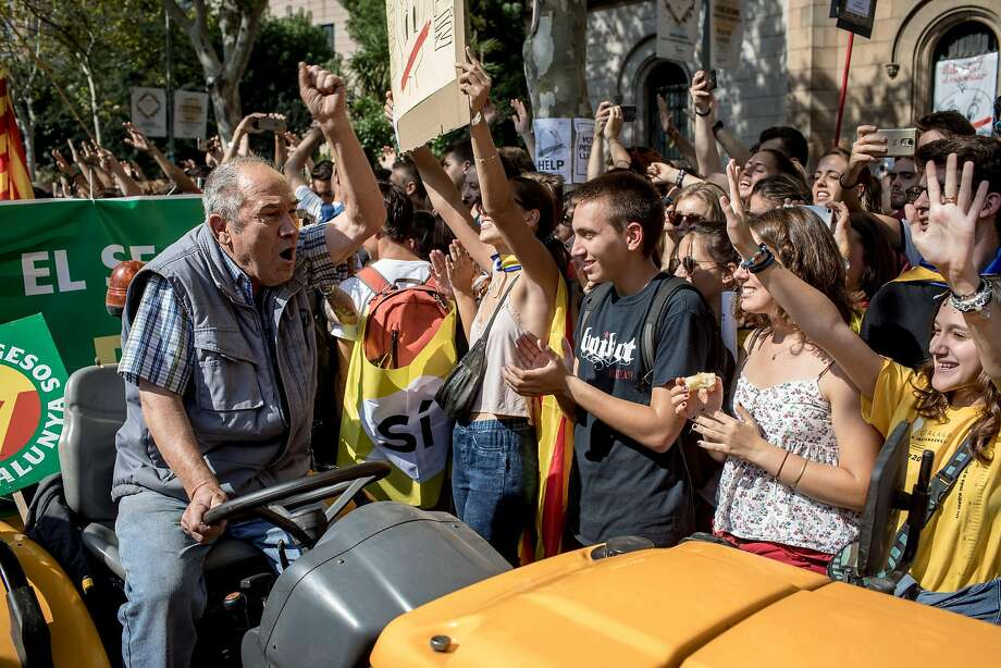 Students cheer at a farmers union demonstration in Barcelona in support of the referendum on independence from Spain. Photo: Chris McGrath, Getty Images
