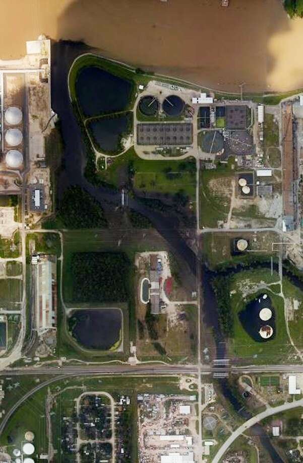 An aerial photo shows floodwaters surrounding the U.S. Oil Recovery Superfund site outside Houston. flowing into the San Jacinto River. The Environmental Protection Agency says it has found no evidence that toxins washed off the site, but is still assessing damage. (National Oceanic and Atmospheric Administration via AP) Photo: AP