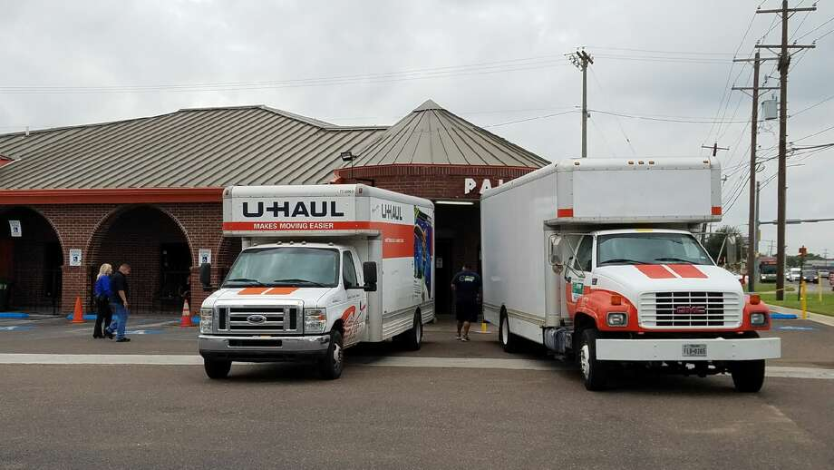 U-Haul trucks line up in front of north Laredo's Palace, where local, state and federal law enforcement agencies simultaneously raided several locations Friday morning. Photo: Cesar Rodriguez/Laredo Morning Times