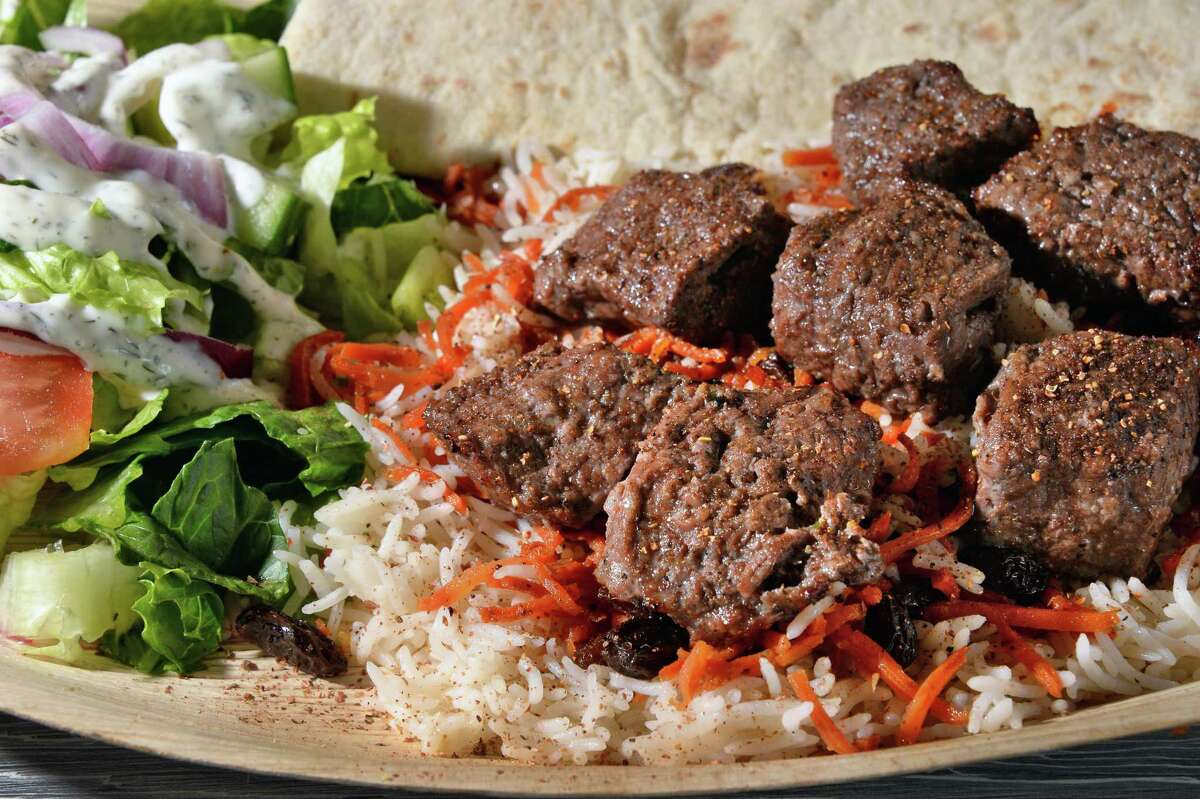 Angus Beef Kabob with Kabuli topping (carrots and raisins) at Zaitoon Kitchen Tuesday Sept. 19, 2017 in Colonie, NY. (John Carl D'Annibale / Times Union)