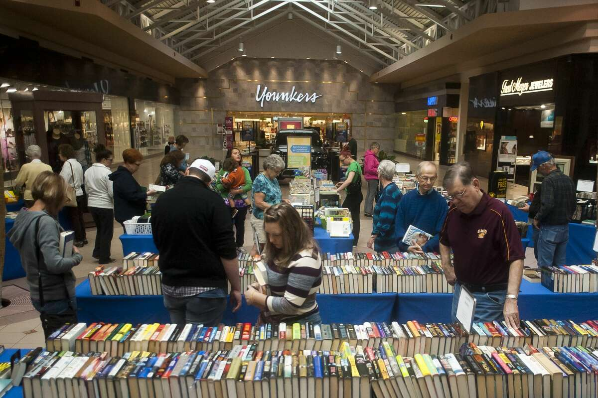 Shoppers peruse thousands of books during the annual AAUW book sale Friday, Sept. 29, 2017 at Midland Mall. The sale began on Friday morning and continues through Sunday, Oct. 1. (Katy Kildee/kkildee@mdn.net)