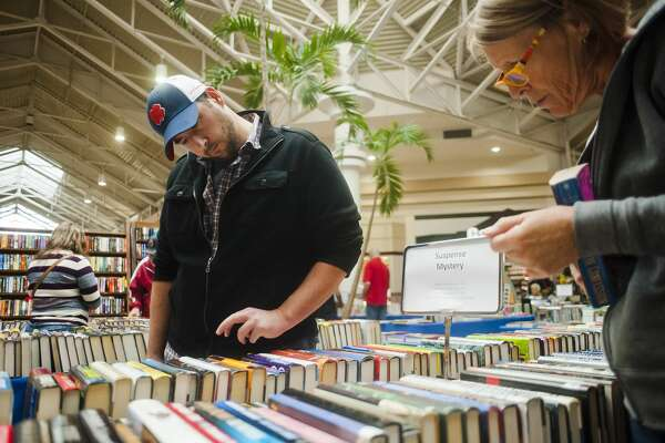Jamey Jacovitch of Midland County, left, and Win Green of Beaverton, right, peruse books in the Suspense/Mystery section during the annual AAUW book sale Friday, Sept. 29, 2017 at Midland Mall. The sale began on Friday morning and continues through Sunday, Oct. 1. (Katy Kildee/kkildee@mdn.net)