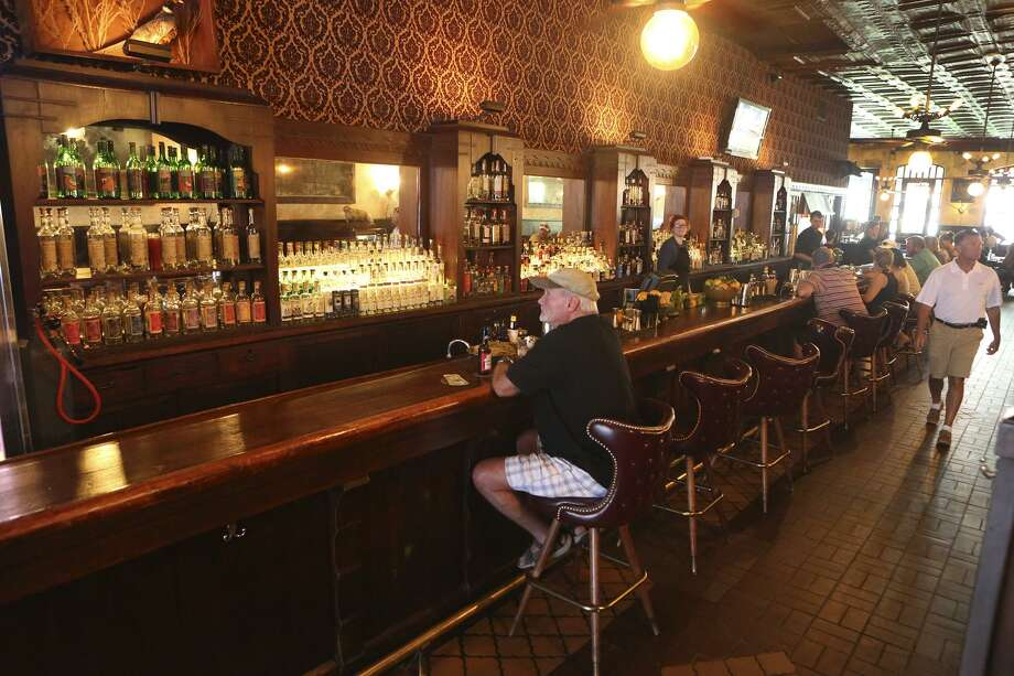 The Esquire Tavern in downtown San Antono opened in 1933 and boasts the longest wooden bartop in Texas. Now a trendy restaurant and bar, the Esquire does a brisk lunch and dinner service. Photo: John Davenport /San Antonio Express-News / ©John Davenport/San Antonio Express-News