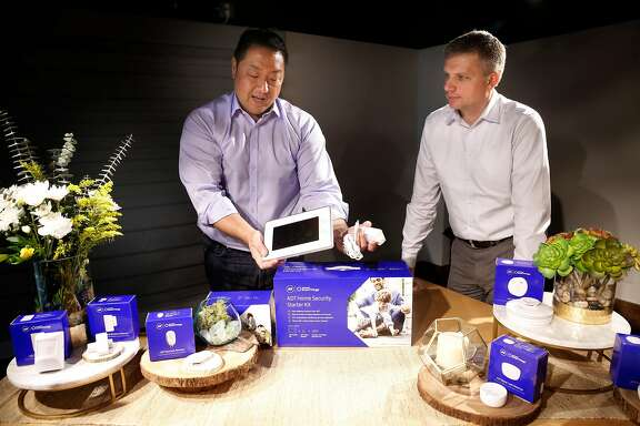 Bill Lee, Samsung's VP of smart home product marketing,(left) and Jay Darfler, senior VP of emerging markets, with the security firm ADT announced a partnership today  in San Francisco, Ca., on Tues. Sept. 26, 2017, unveiling their new home security system.
