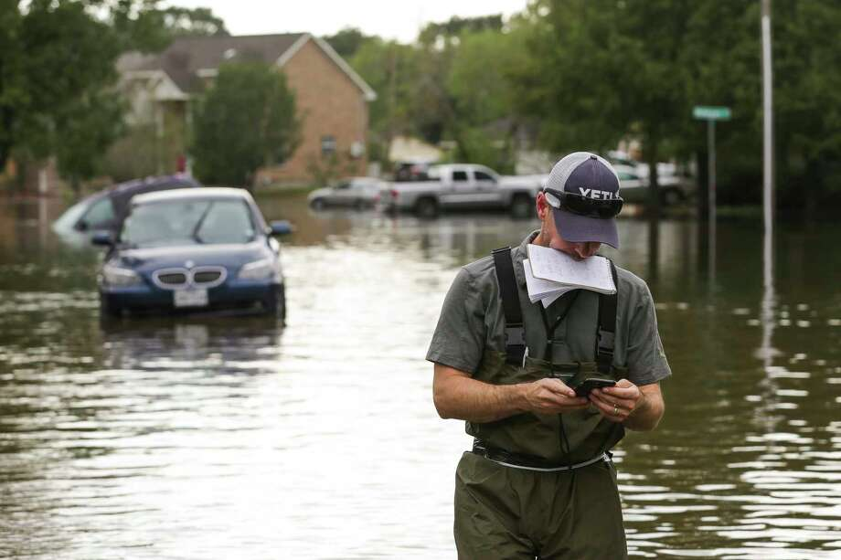 Houston Chronicle reporter David Hunn walks through floodwaters in the Hickory Creek neighborhood after Tropical Storm Harvey Wednesday, Aug. 30, 2017 in Pearland. Photo: Michael Ciaglo, Houston Chronicle / Michael Ciaglo