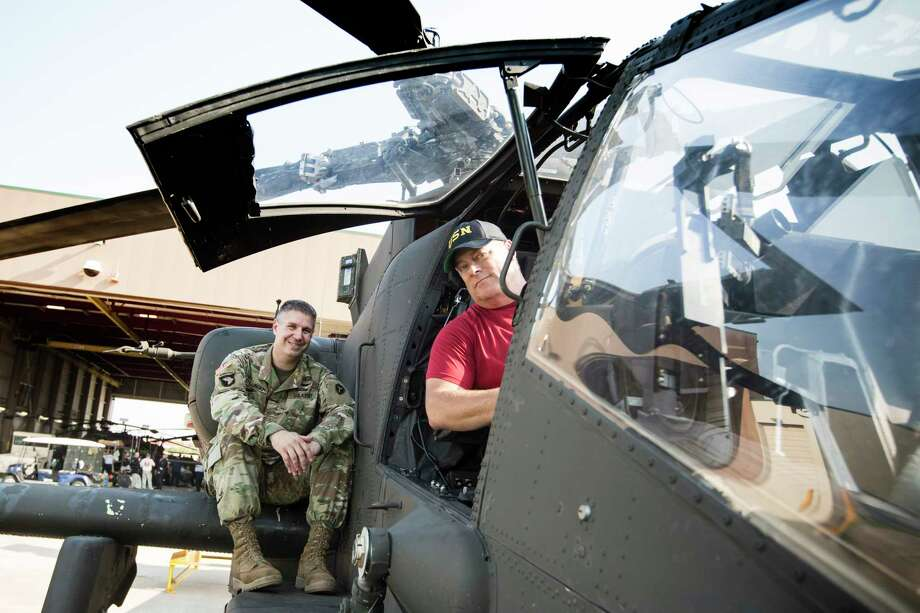 Houston Chronicle photographer Brett Coomer sits in the cockpit of a Texas National Guard Apache helicopter with Maj. Randall Stillinger while waiting to fly on a Tropical Storm Harvey relief mission with the National Guard on Thursday, Aug. 31, 2017, in Houston. ( 1Lt Zach West / Texas National Guard ) Photo: 1Lt Zach West, Texas National Guard / © 2017 Houston Chronicle