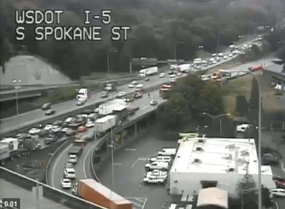 A crash on southbound Interstate 5 snarled traffic Friday morning at Spokane Street in Seattle.  Photo: DoT