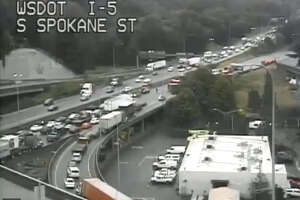 A crash on southbound Interstate 5 snarled traffic Friday morning at Spokane Street in Seattle.