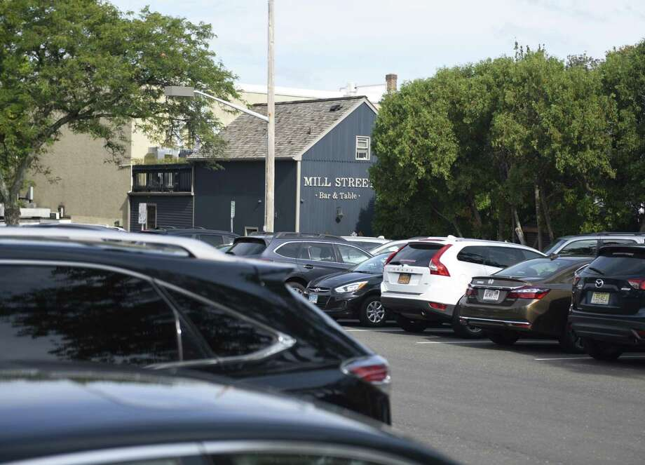 The free 8-hour municipal parking lot is completely full in the Byram section of Greenwich, Conn. Thursday, Aug. 21, 2017. Byram businesses have noticed a parking shortage downtown, largely resulting from Port Chester employees parking in the free Byram municipal lot and then getting a ride or walking over to Port Chester. Photo: Tyler Sizemore / Hearst Connecticut Media / Greenwich Time