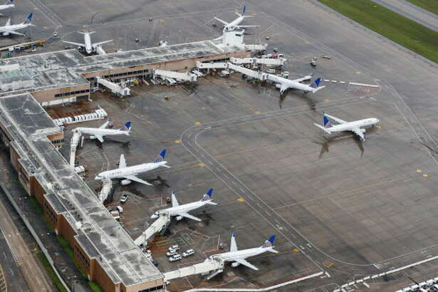 Aircraft sit idle at George Bush Intercontinental Airport, which has been closed by Tropical Storm Harvey, on Tuesday, Aug. 29, 2017, in Houston. ( Brett Coomer / Houston Chronicle )