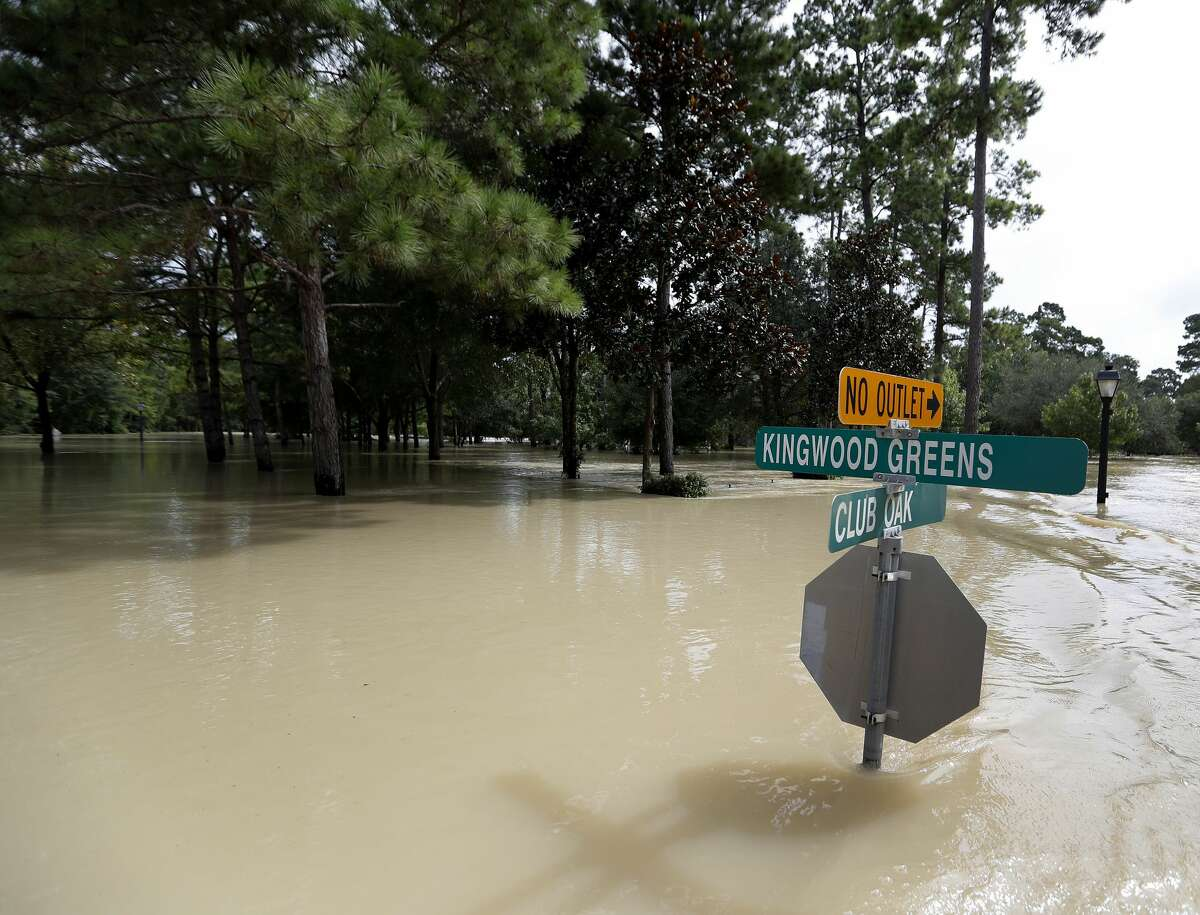 Flooding from the San Jacinto River laps at street signs in Kingwood during Tropical Storm Harvey on Aug. 30 in Kingwood.