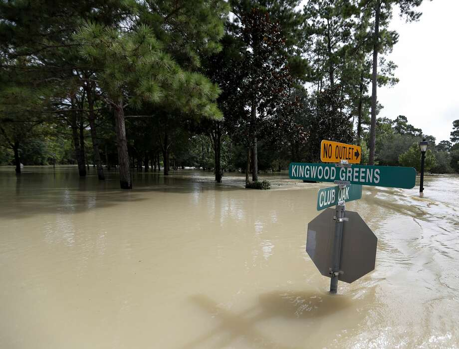 Flooding from the San Jacinto River laps at street signs in Kingwood during Tropical Storm Harvey on Aug. 30 in Kingwood. Photo: Karen Warren/Houston Chronicle