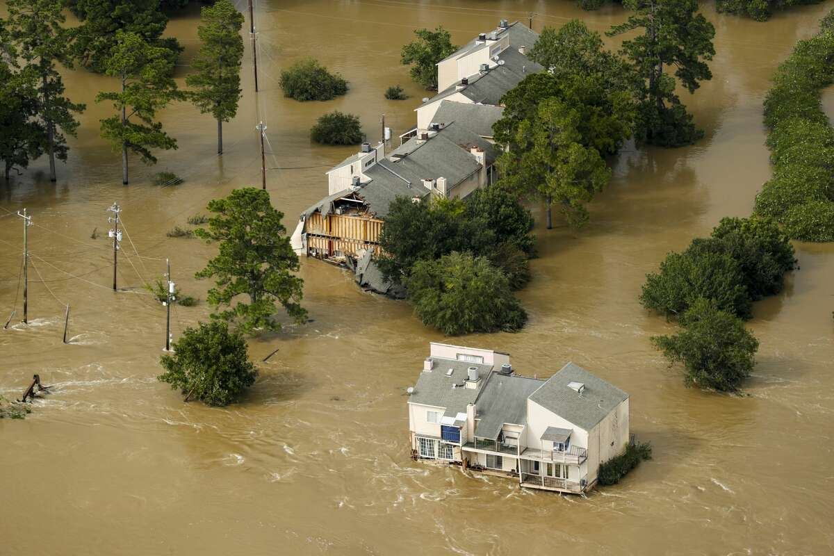 Floodwaters from the San Jacinto River in the aftermath of Hurricane Harvey surround condominiums in Kingwood.